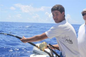 "Alex cranking on a big tiger shark at ""Challenger Bank"" of Bermuda"